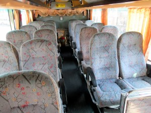 Seats inside The Transport Company 2nd Class bus