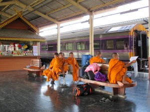 Novice monks waiting for their train