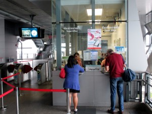 people buying tokens at Phaya Thai ticket counters