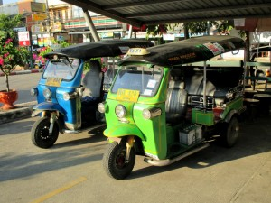 Tuk Tuks in the parking lot at the train station