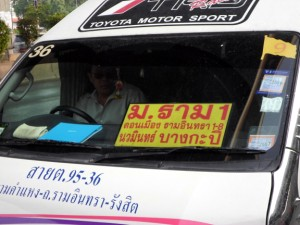 minibus services with the destination written in Thai