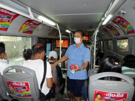 Ticket collector on a bus in Bangkok