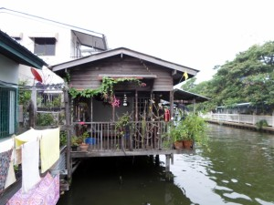 Picture of a wooden house by the canal