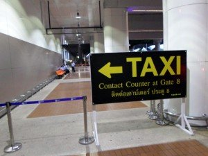 taxi stand sign at gate 8