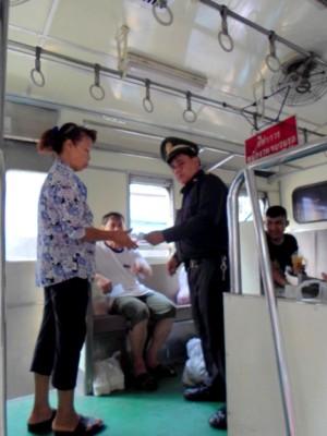 ticket inspector checking tickets